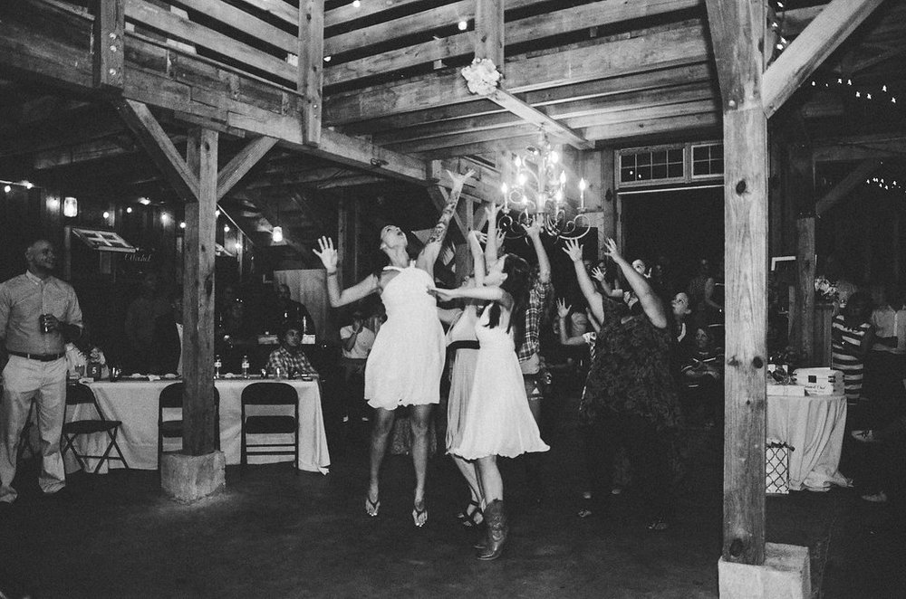 bouquet toss wedding reception photo