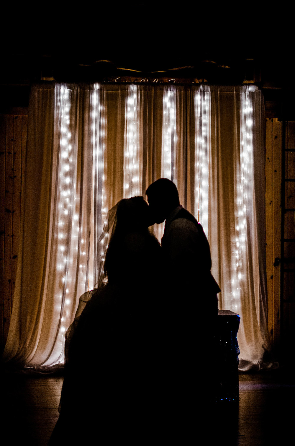 bride and groom dancing silhouette photo