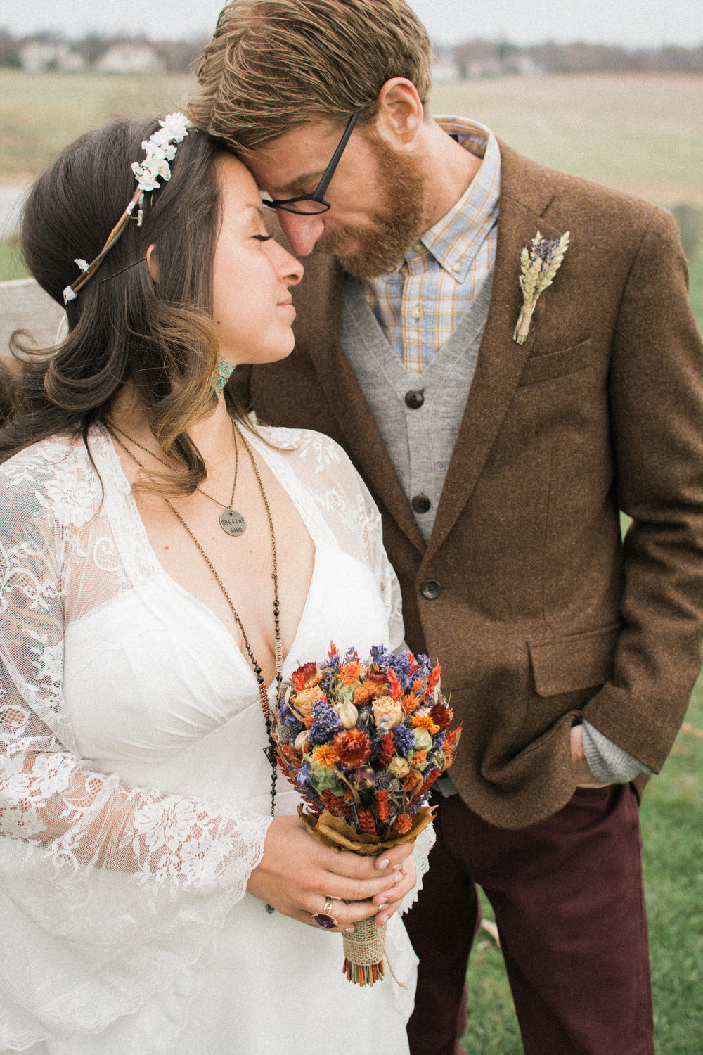 hippy chic bride and groom embracing photo