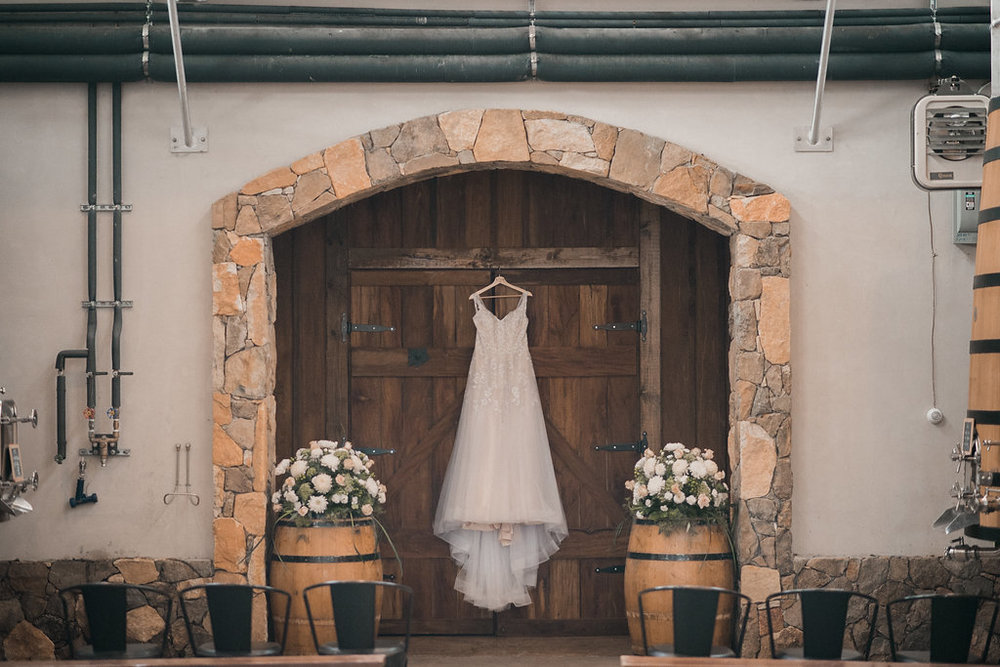 wedding dress for bride getting ready at stone tower winery photo