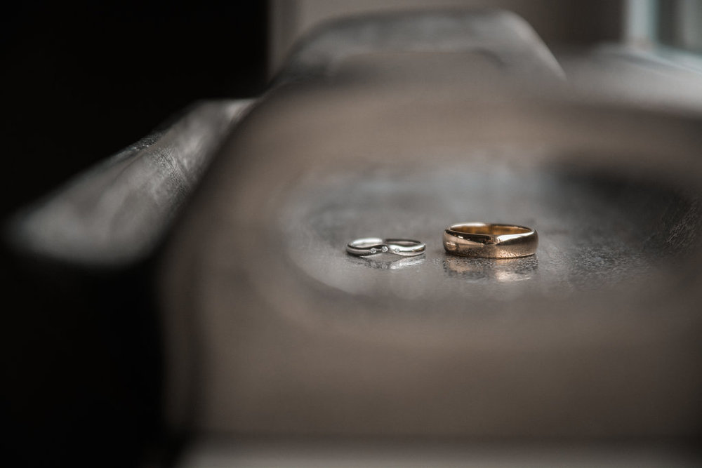 wedding rings detail shot at stone tower winery photo