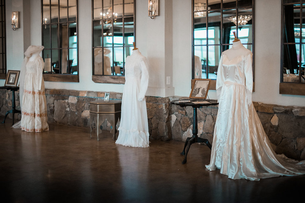 family heirloom wedding gowns reception details at stone tower winery wedding photo