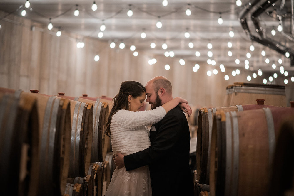 bride and groom romantic dramatic at stone tower winery wedding photo