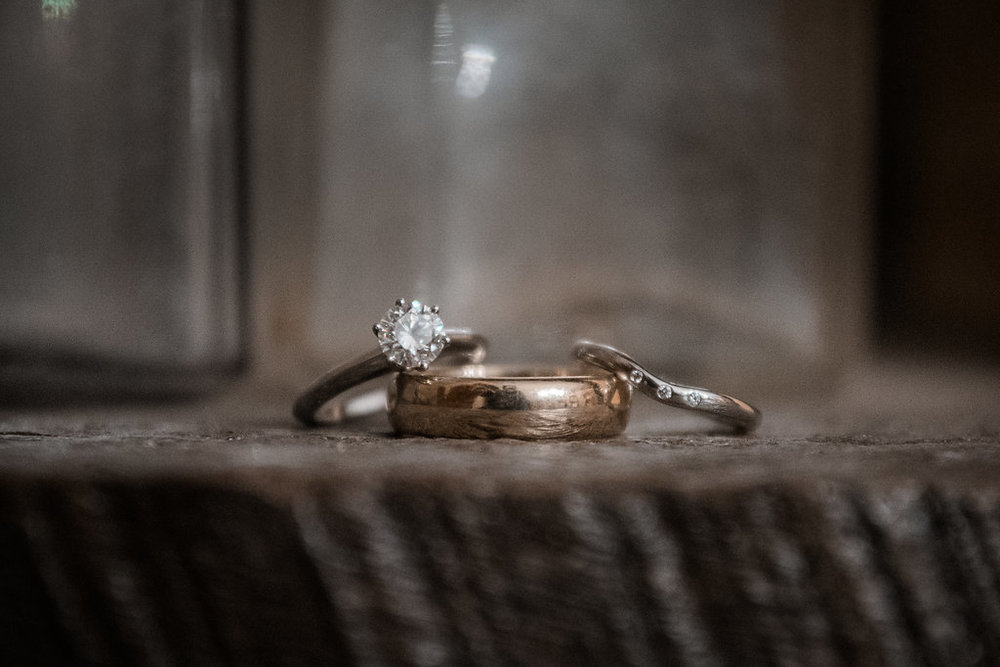 wedding rings at stone tower winery photo