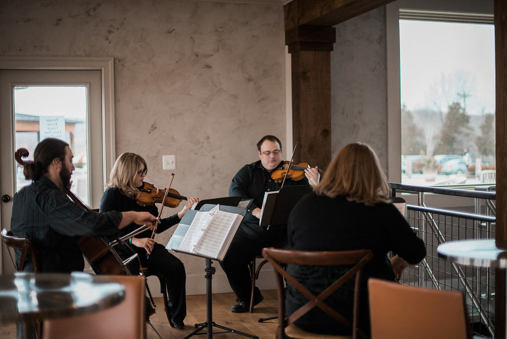 black tie string quartet at stone tower wedding photo