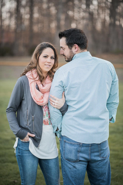 man looking at woman on baseball field