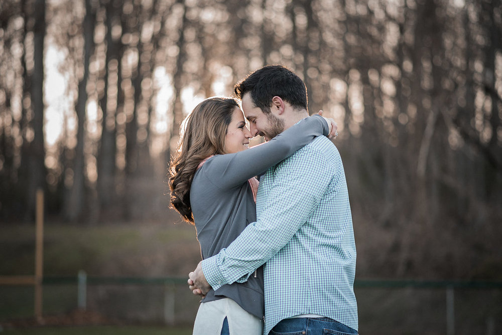 couple embracing on baseball field