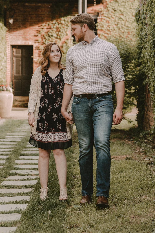 Man and woman walking through courtyard