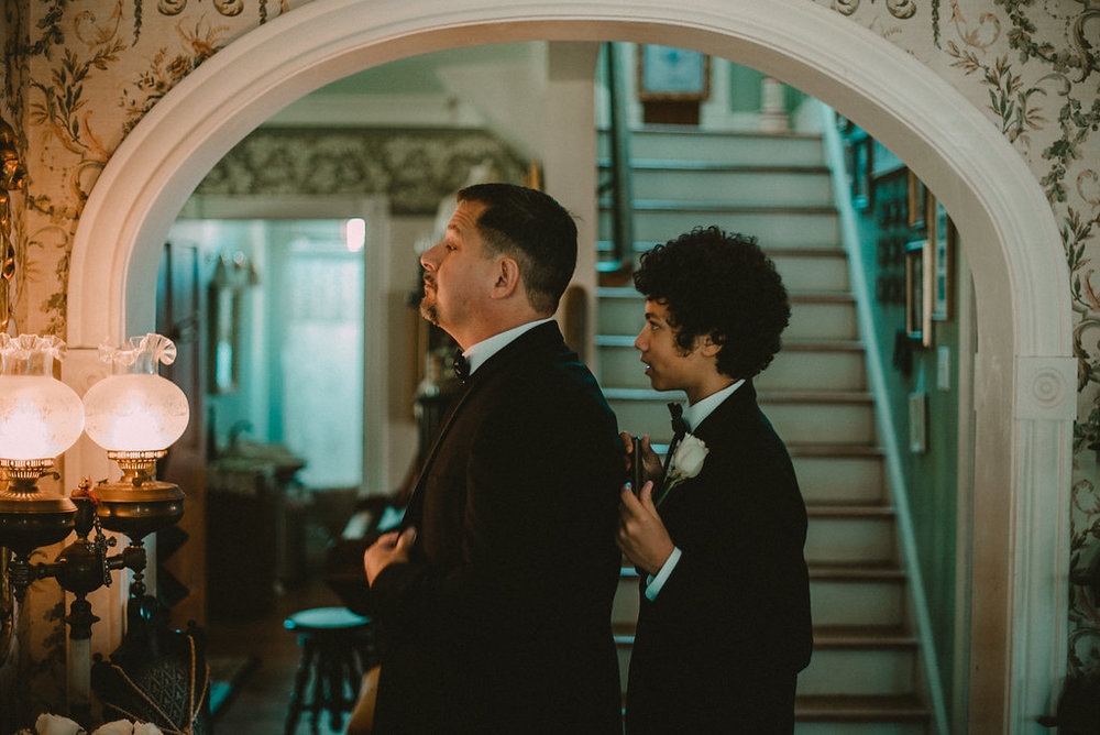 Men in tuxedos getting ready for wedding