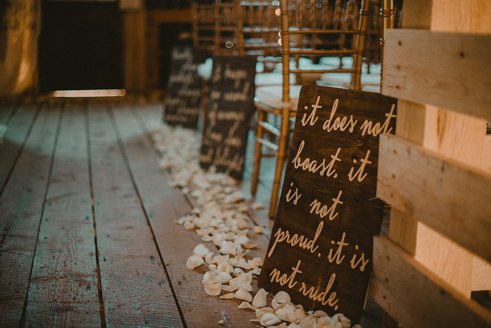 Wedding aisle with flowers in barn