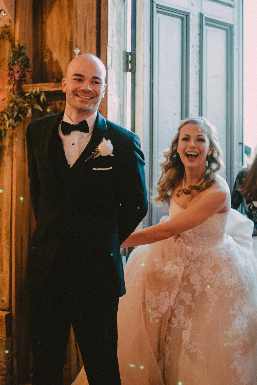 Bride and groom coming through door