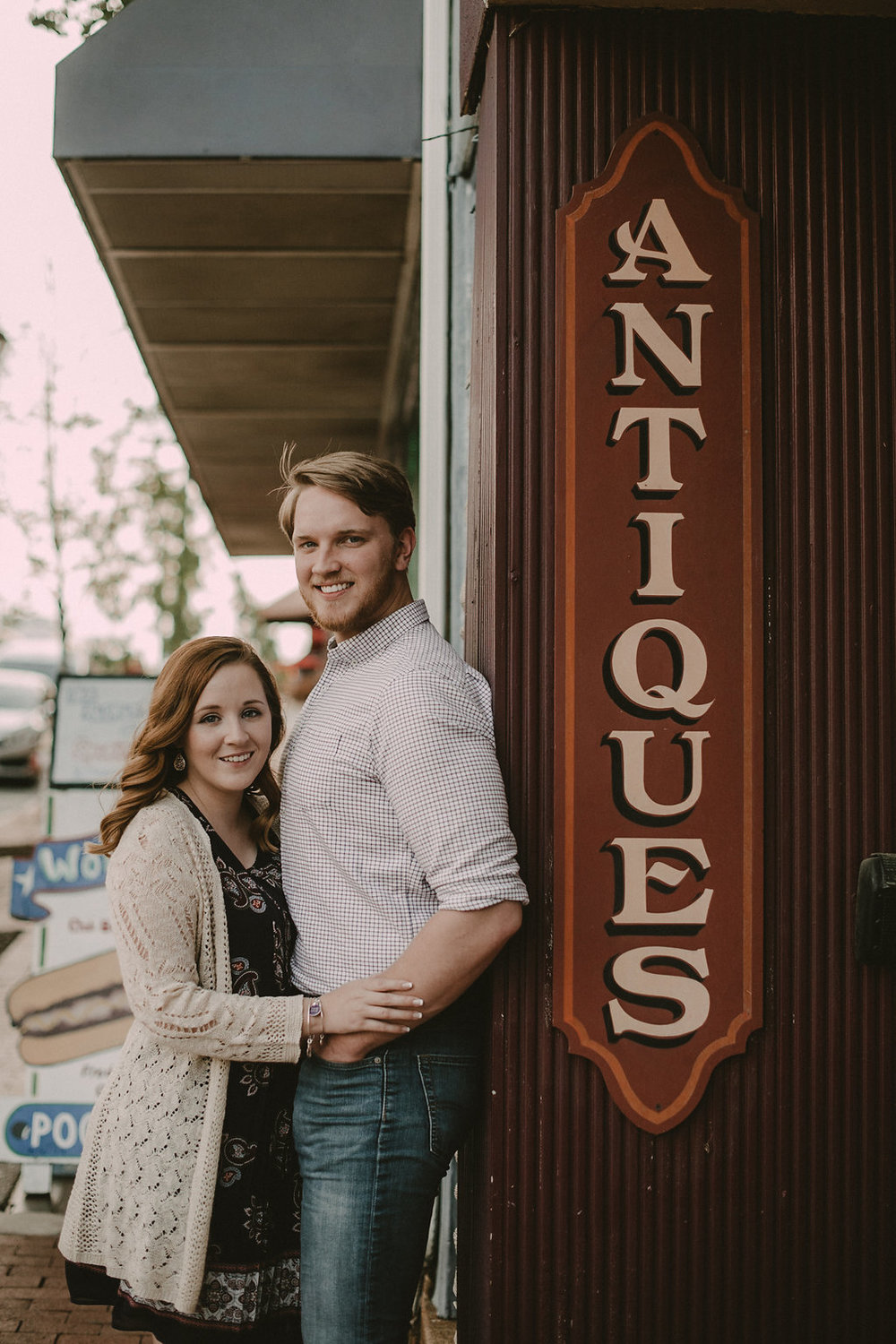 couple in Fredericksburg va for engagement session at antique shop photo