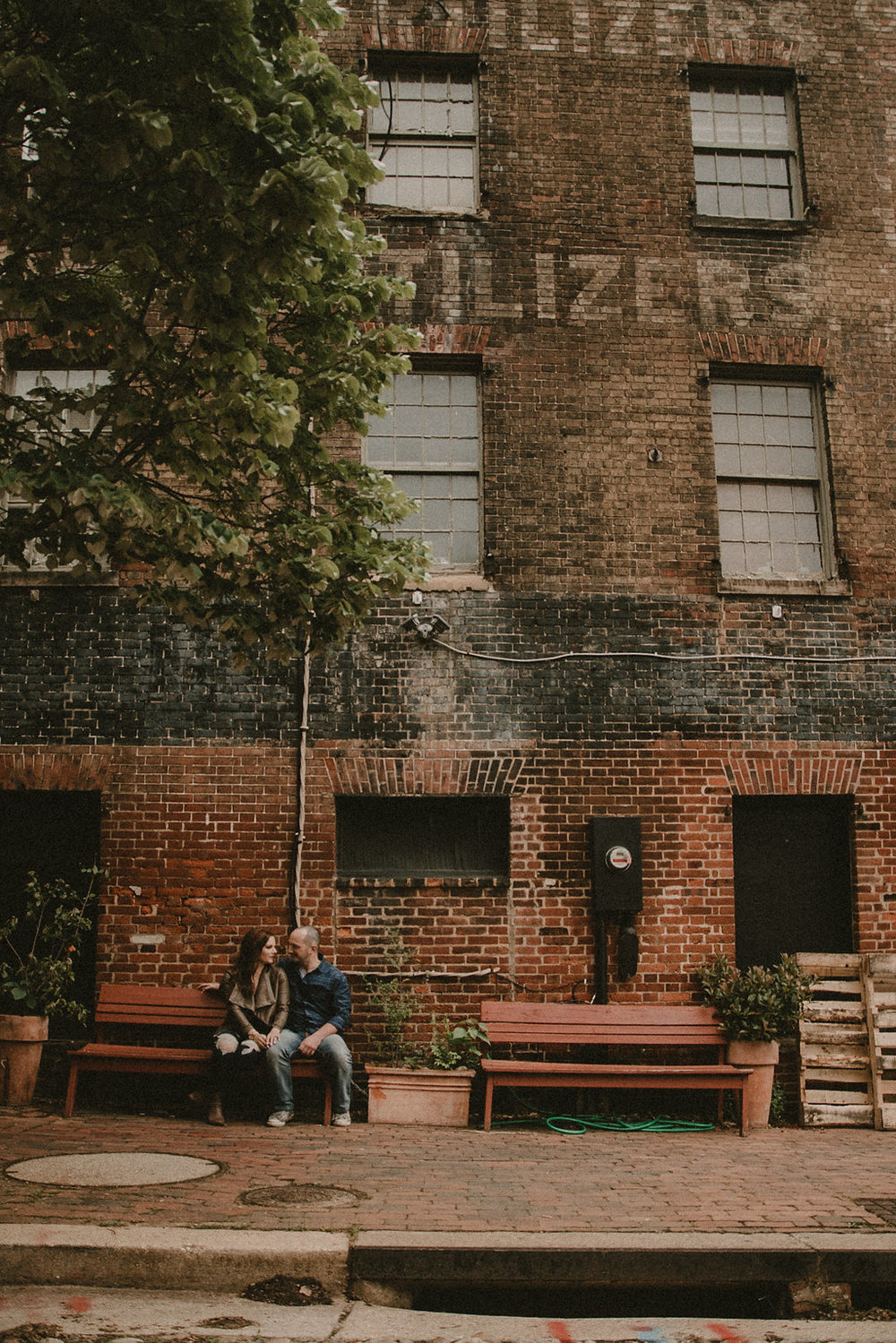Couple sitting on bench far away