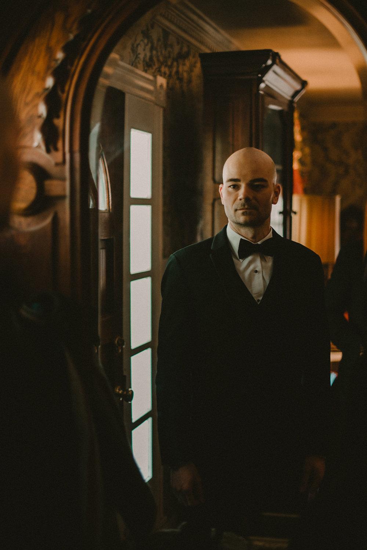 groom in mirror portrait photo