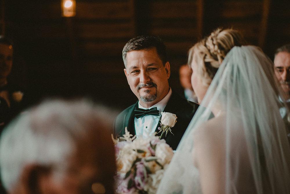 dad giving daughter away at wedding photo