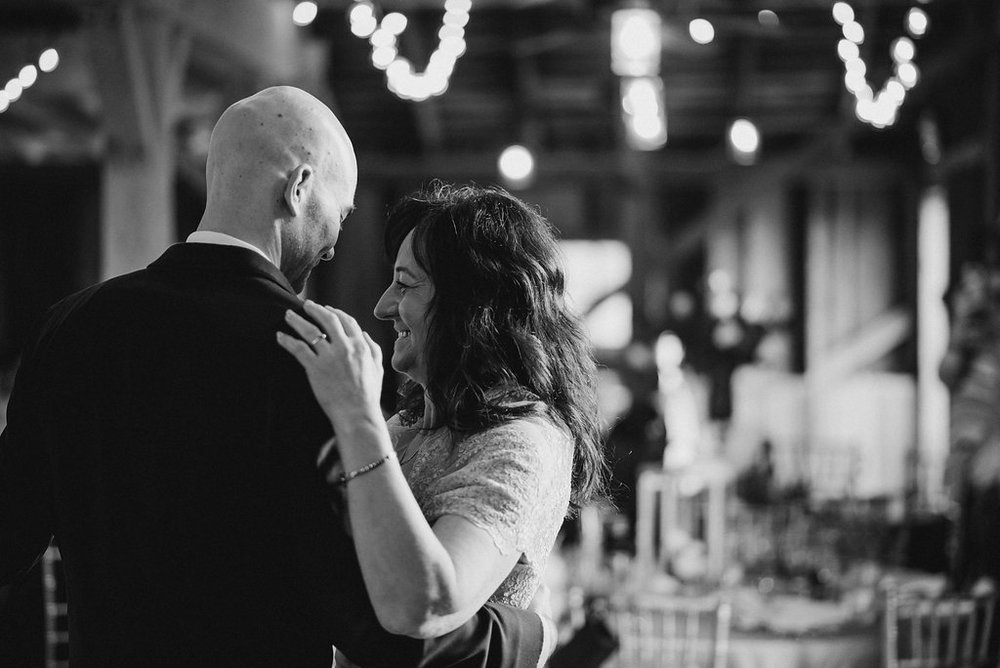Son and mother dance at wedding