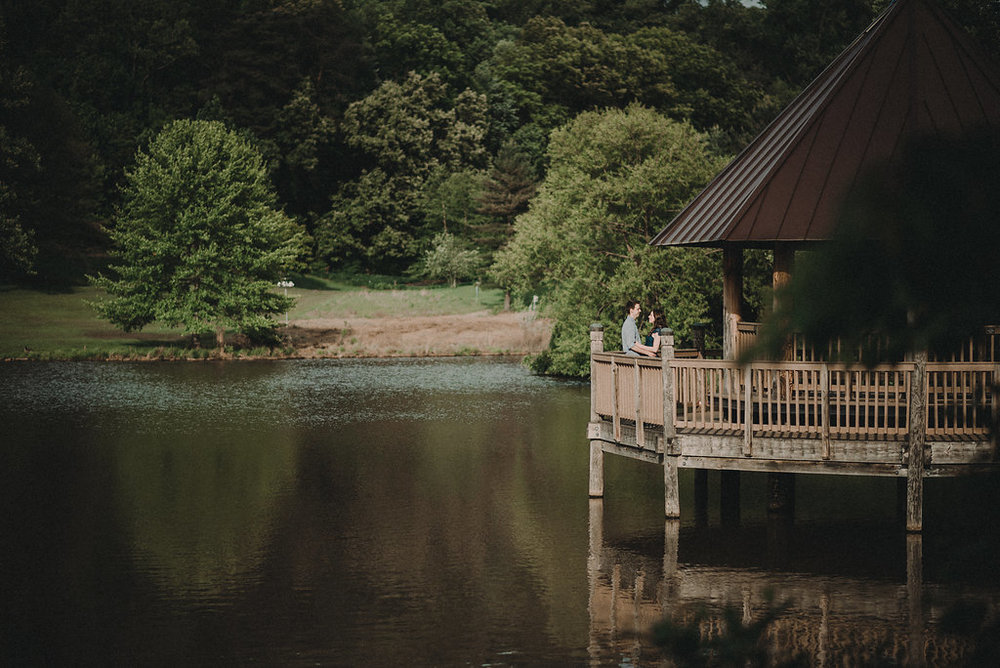 Couple on gazebo on lake