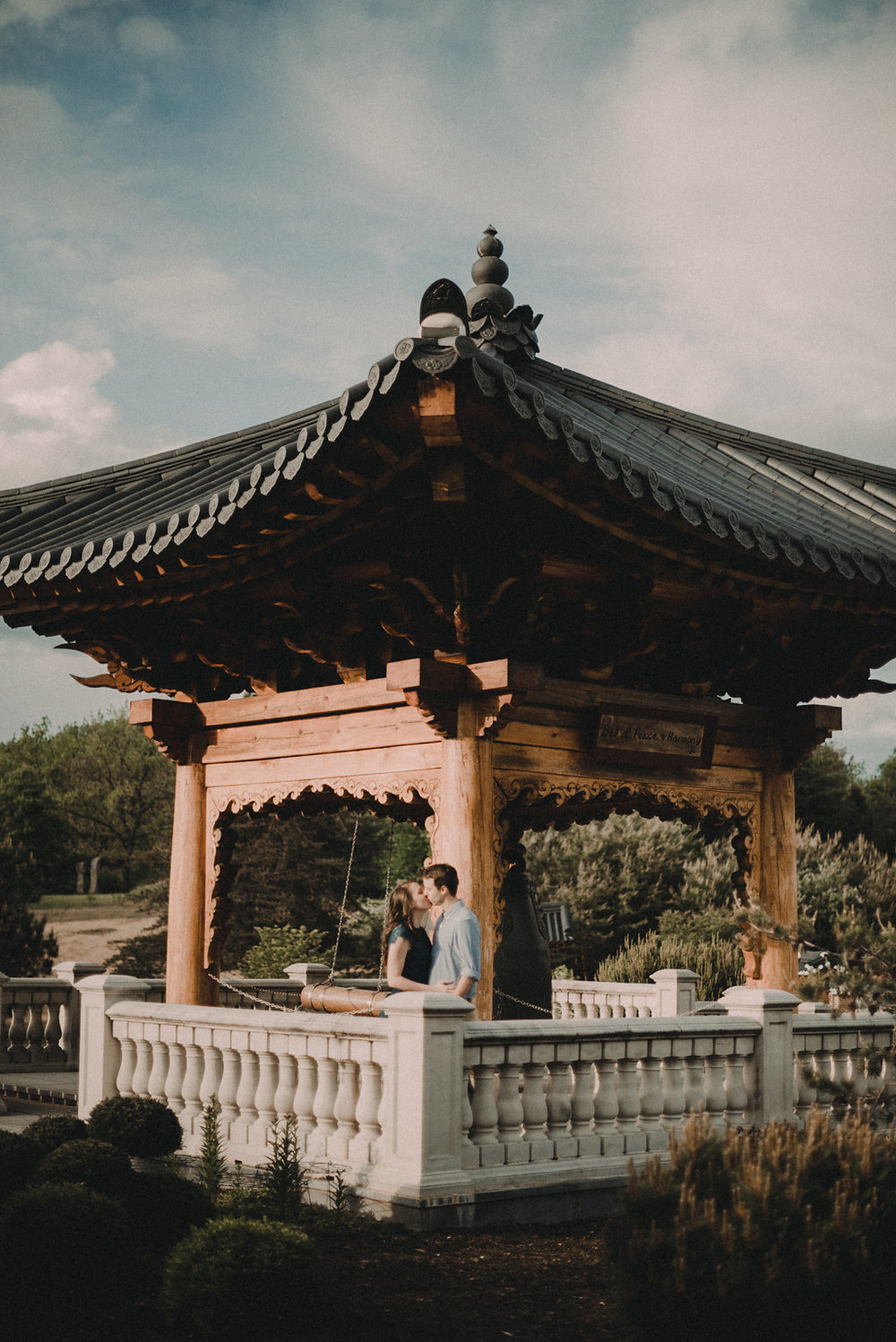 Man and woman kissing at pagoda
