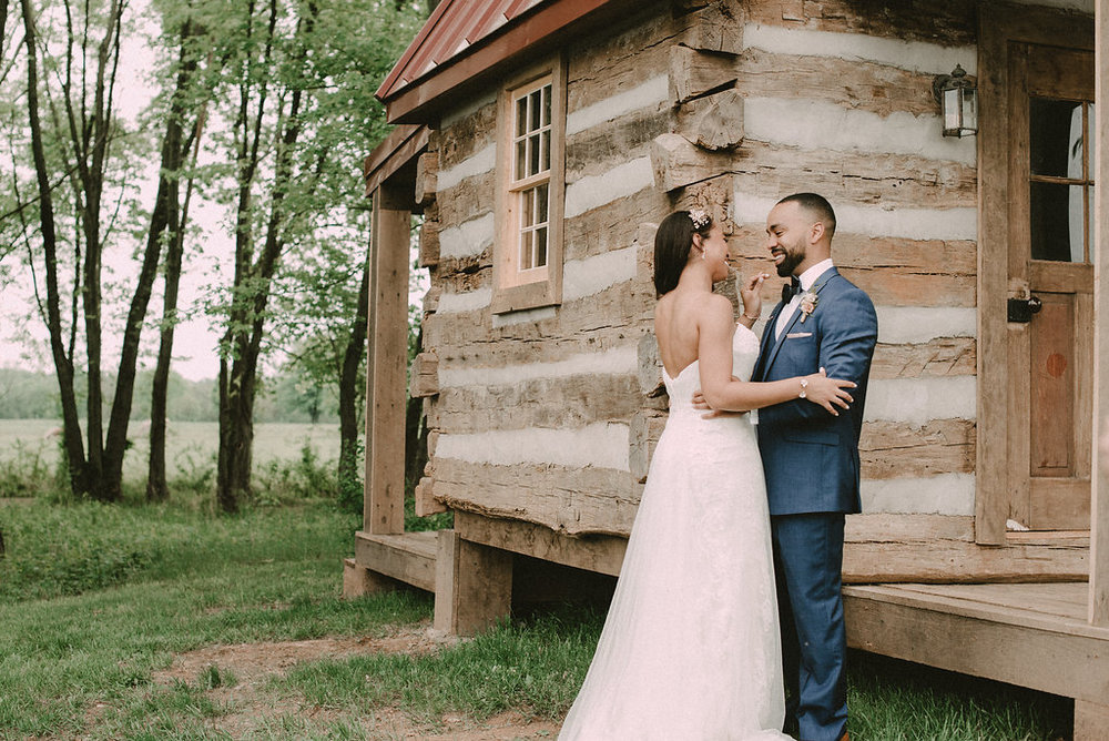 Bride and groom hugging at cabin