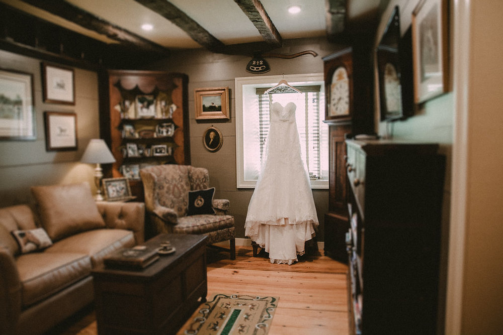 bride dress in rustic cabin room photo