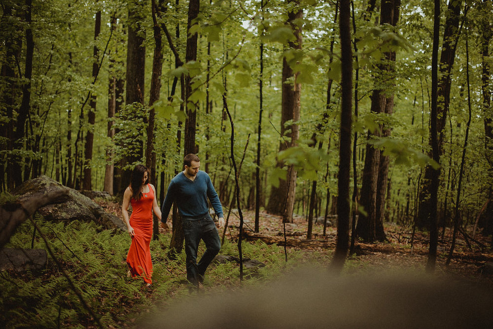 Woman and man walking through woods