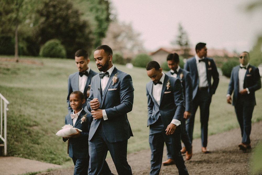 groom walking to alter at rustic wedding photo