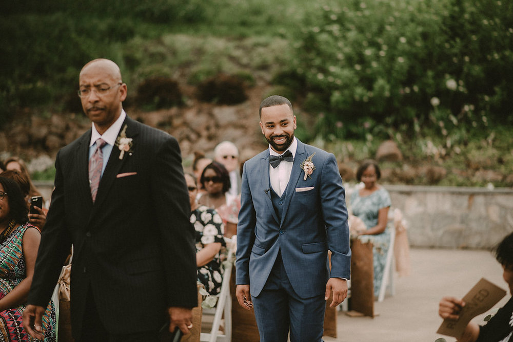 groom walking down wedding aisle to alter photo