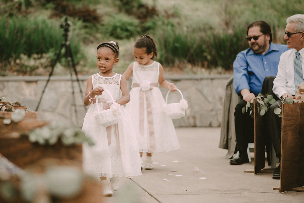 flower girls walking down aisle photo
