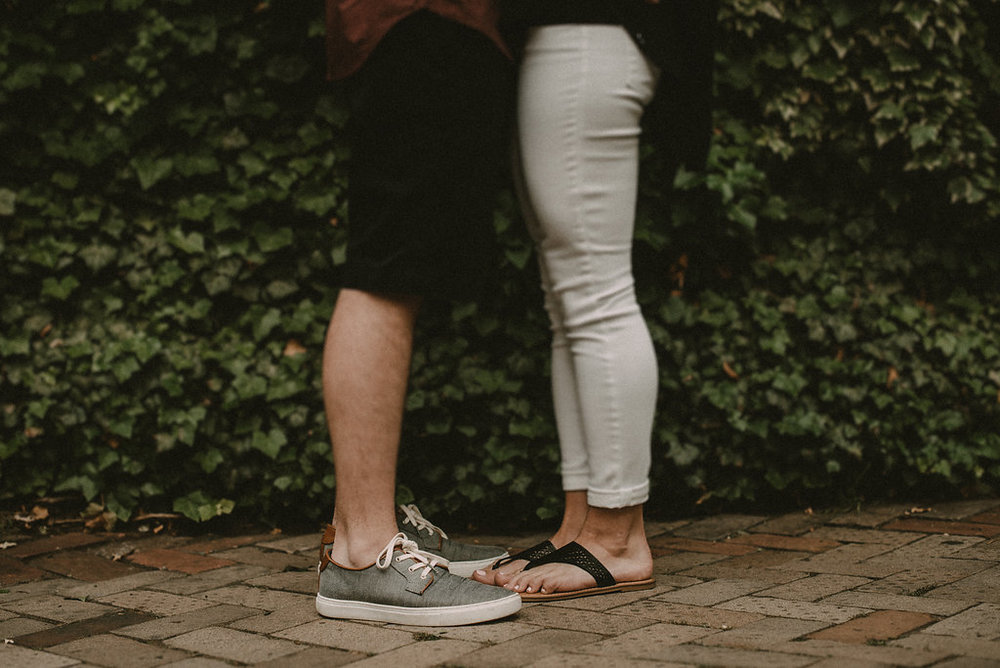 Feet of hugging couple