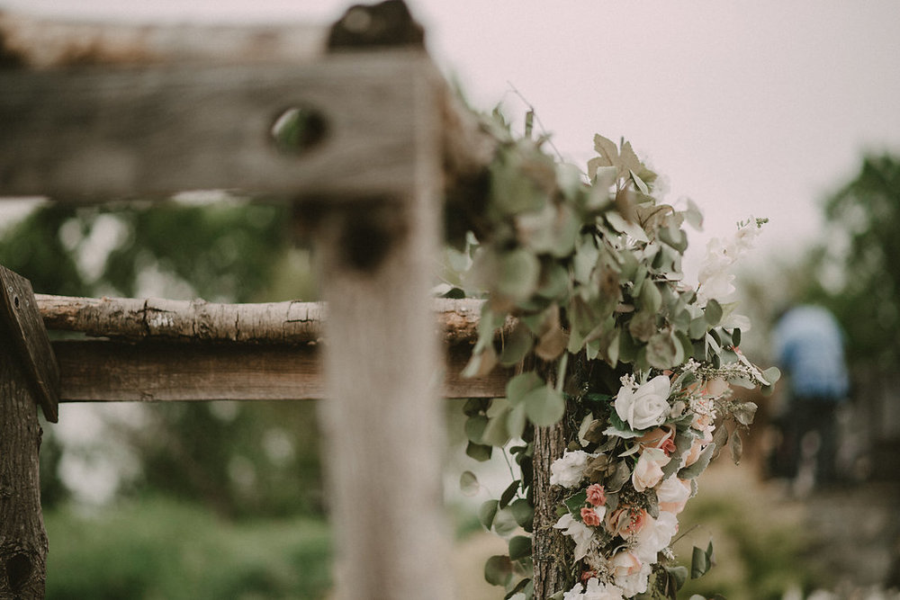 greenery on rustic wedding arbor photo