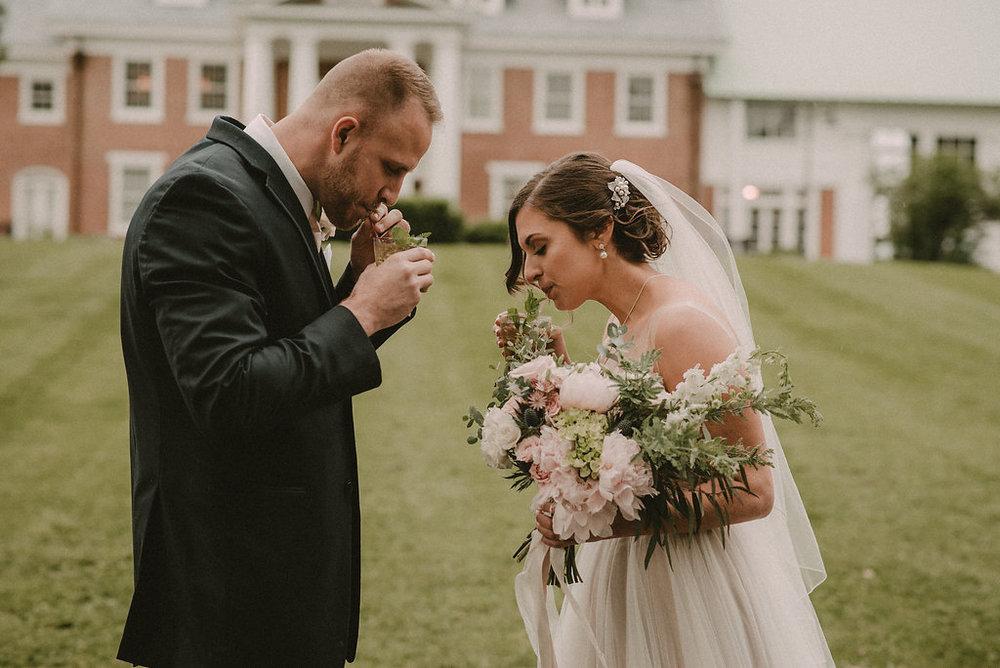 Bride looking at groom mint julep drink photo