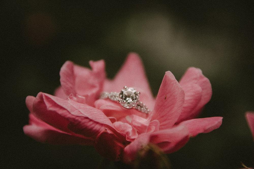 Diamond ring inside of pink flower