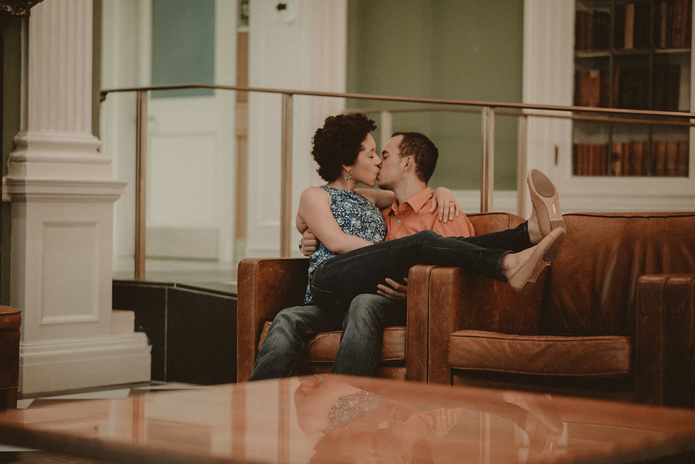 Woman sitting in man's lap and kissing