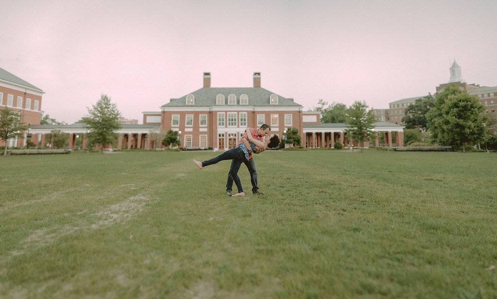 Couple dancing on lawn at university