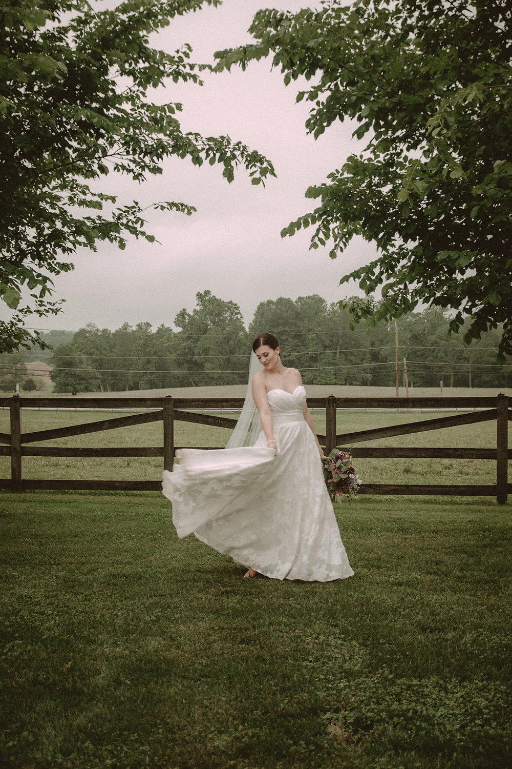 Bride posing in field