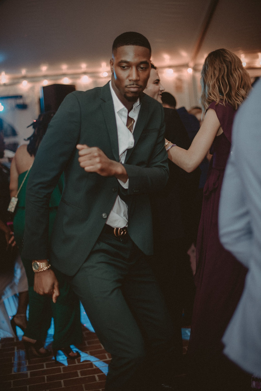 Guest dancing at wedding reception