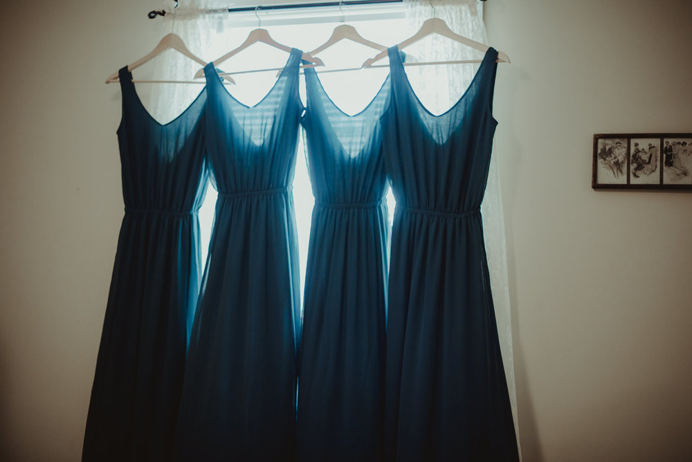 Bridesmaids dresses hanging in window
