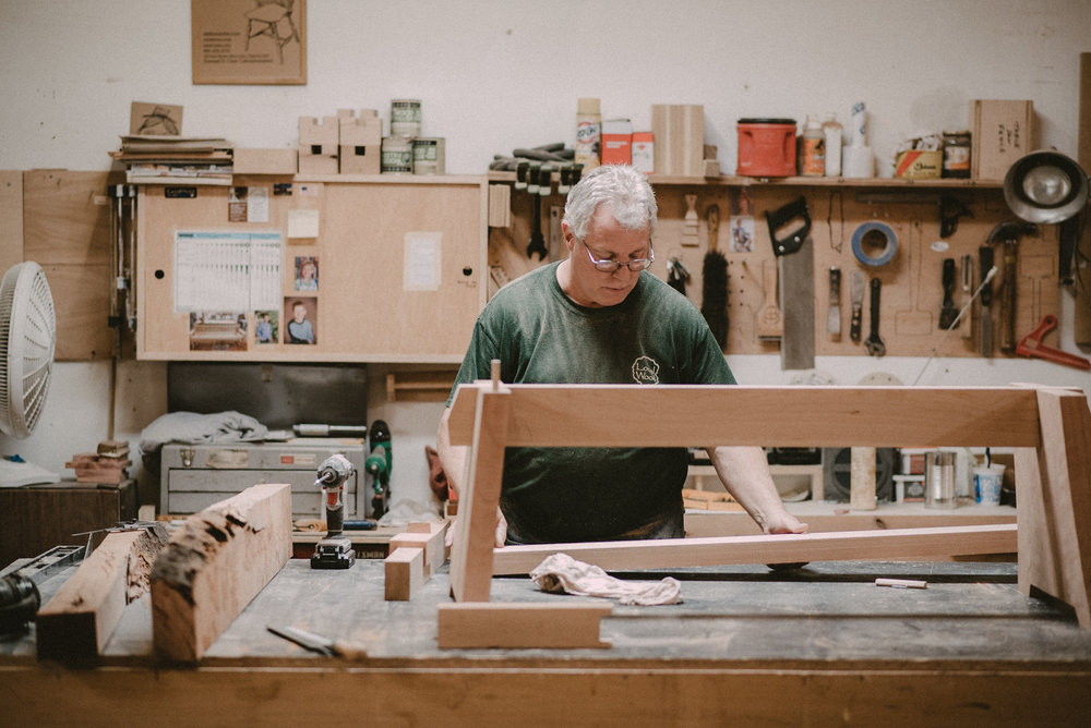 Man building a table at a workbench