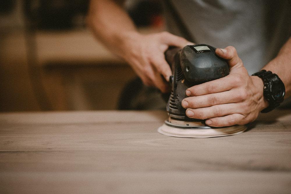 Man sanding tabletop