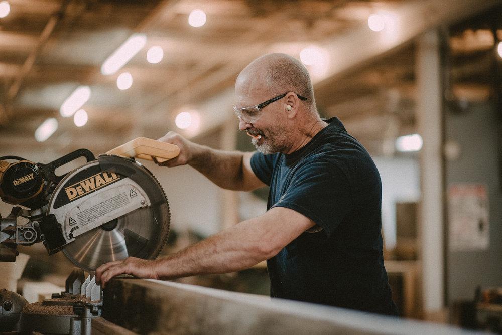 Man using buzz saw
