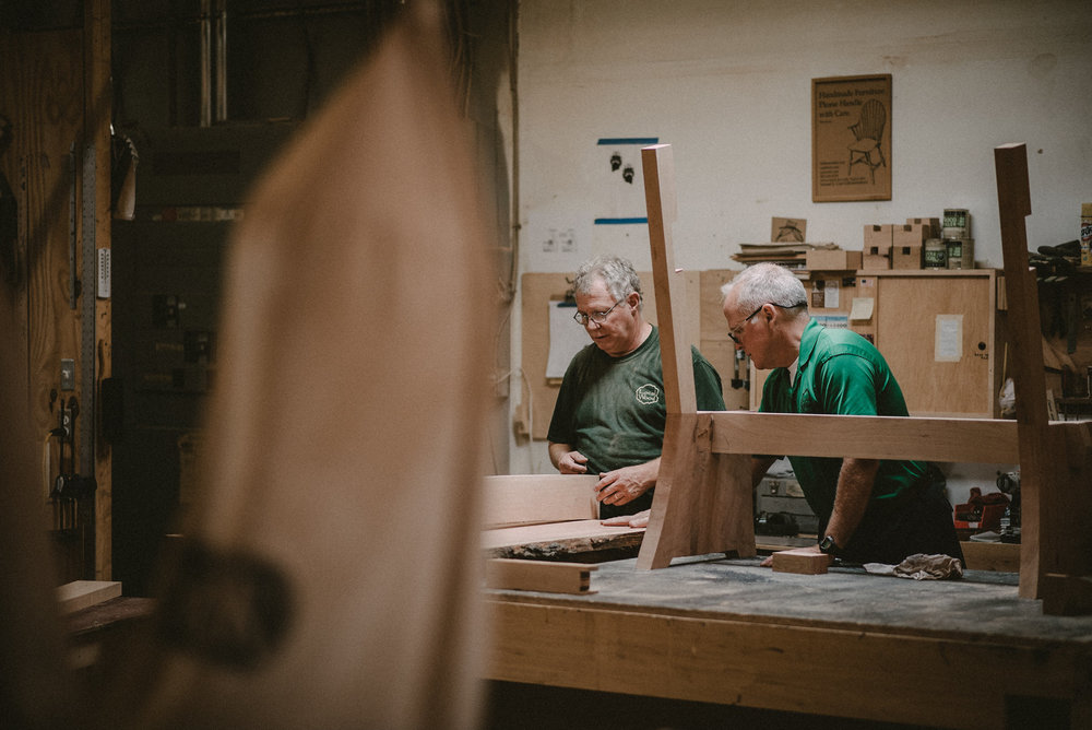 Men working together in wood shop