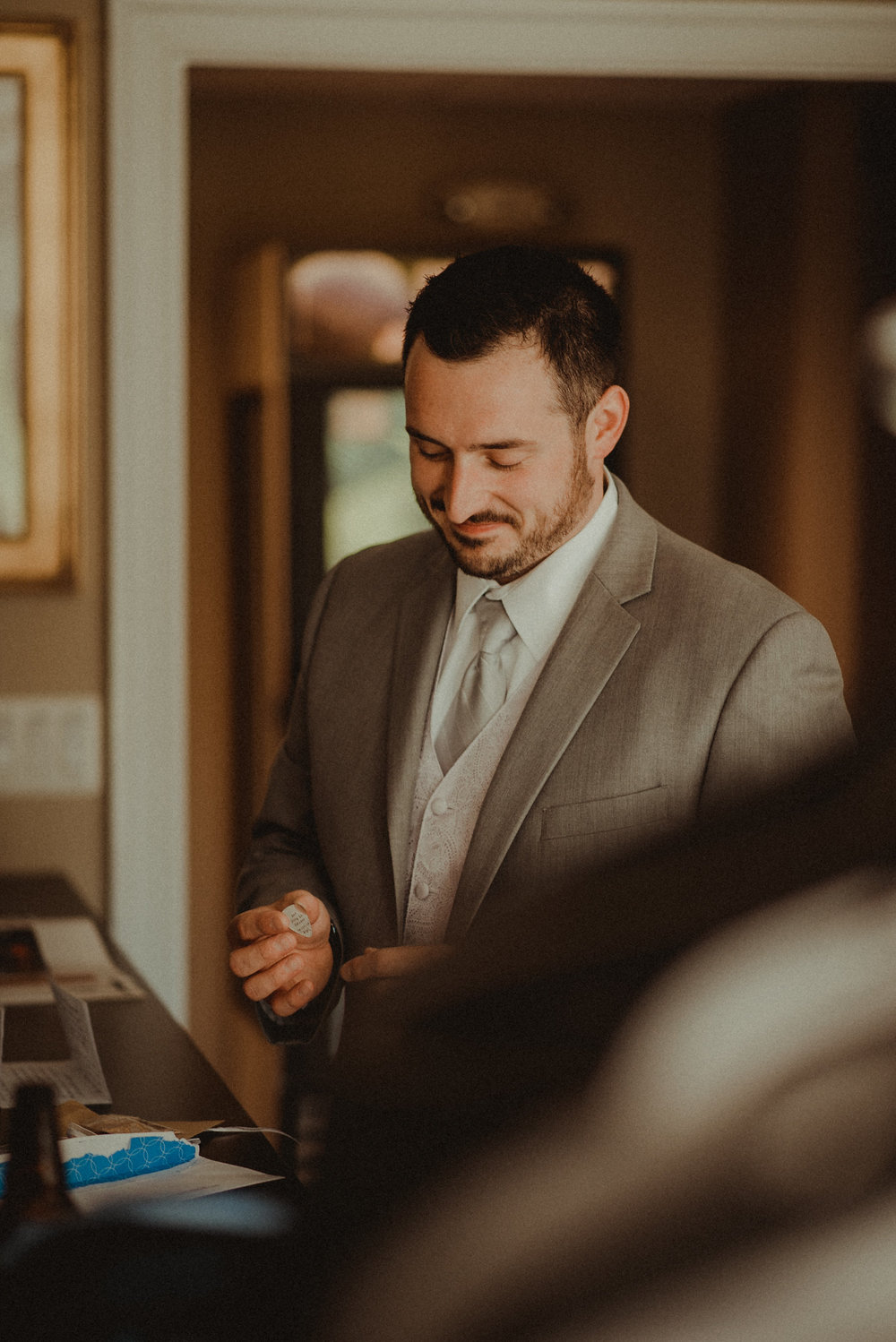 Groom receiving gift from bride