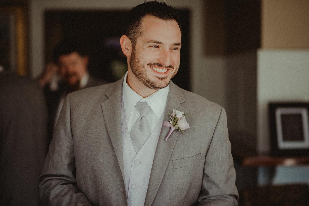 Groom smiling before wedding