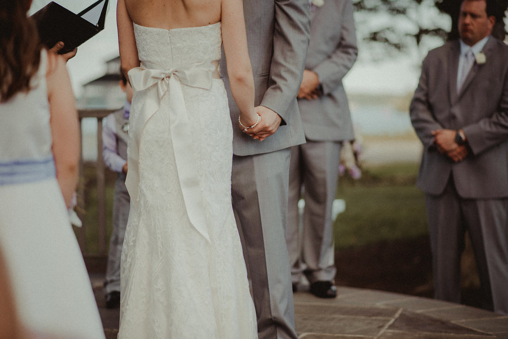 Bride and groom holding hands during ceremony