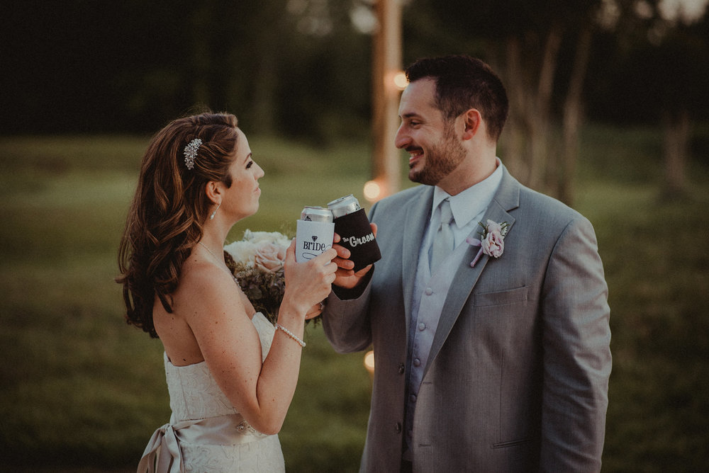 Bride and groom sharing a beer