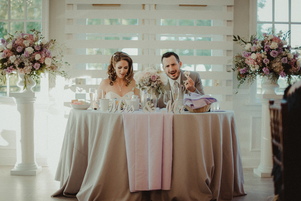 Groom and bride at table