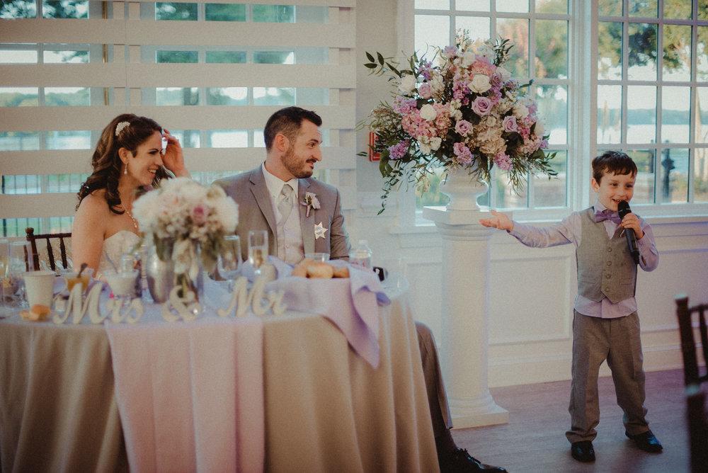 Son giving speech at wedding reception