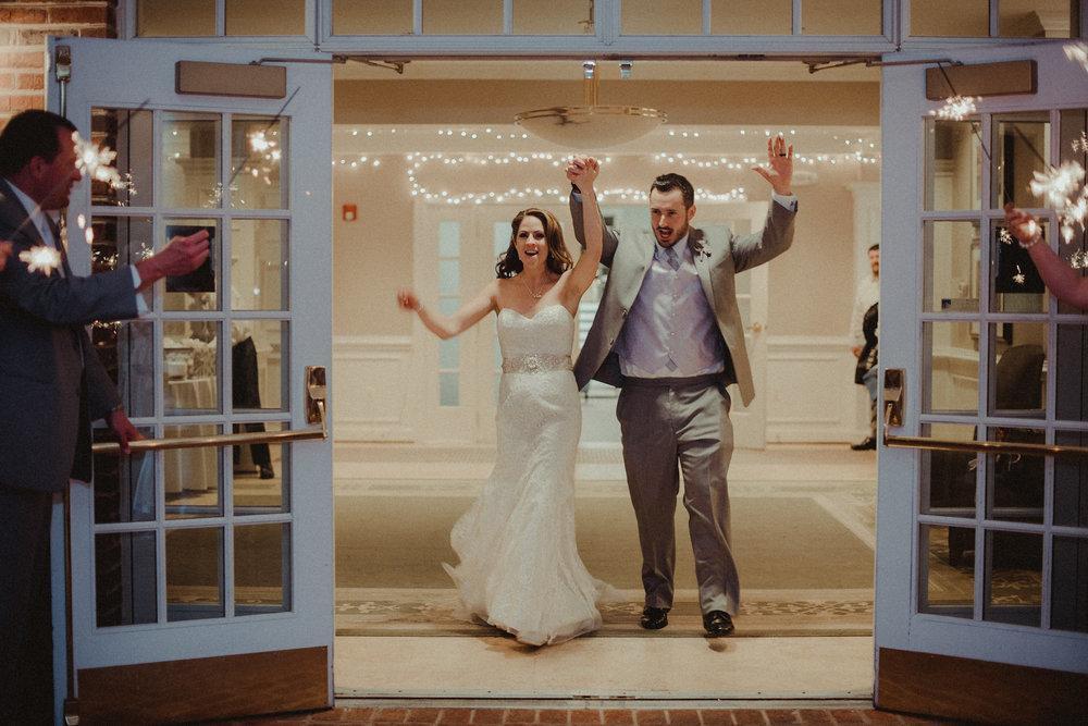 Groom and bride leaving wedding