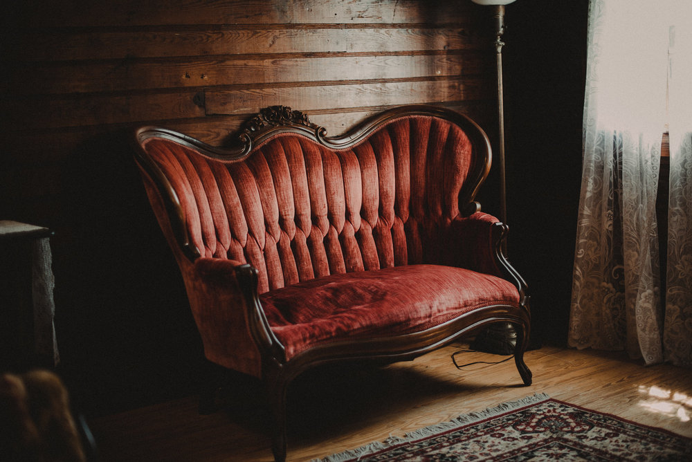Red velvet couch in farmhouse