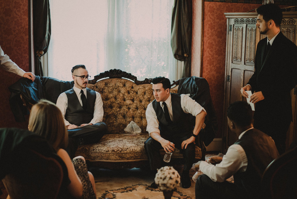 Groomsmen sitting on couch